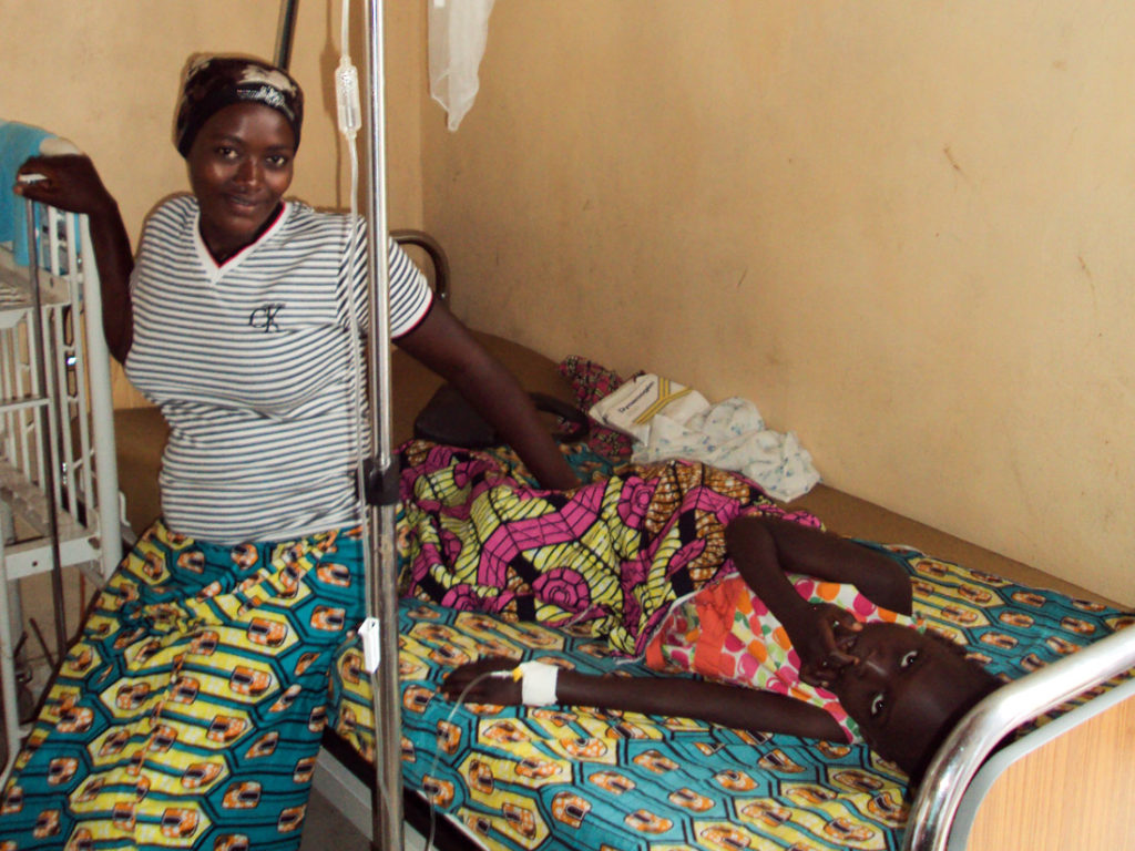 Mädchen mit Malaria und Durchfallerkrankung